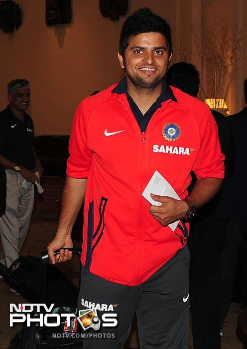 Suresh Raina arrives with his team in Colombo. (AFP Photo)