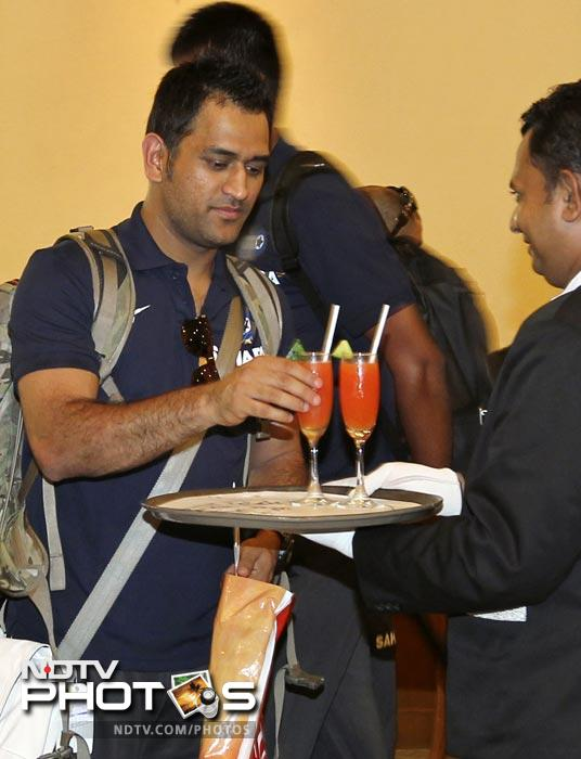 Indian captain Mahendra Singh Dhoni receives a welcome drink upon Indian cricket team's arrival in Colombo. (AP Photo)
