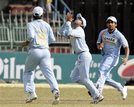 Gautam Gambhir holds a catch to dismiss Malinda Warnapura as Zaheer Khan looks on during the 5th and final One-Day International between India and Sri Lanka on August 29, 2008.