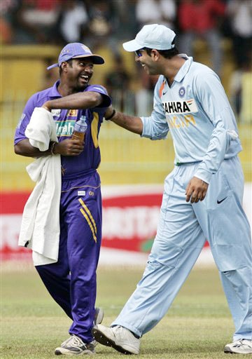 Yuvraj Singh shares a light moment with Muttiah Muralitharan during the 5th and final One-Day International between India and Sri Lanka on August 29, 2008.