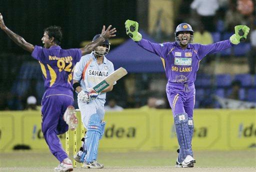 Nuwan Kulasekara and Kumar Sangakkara celebrate the dismissal of Indian batsman Gautam Gambhir during the 5th and final One-Day International between India and Sri Lanka on August 29, 2008.