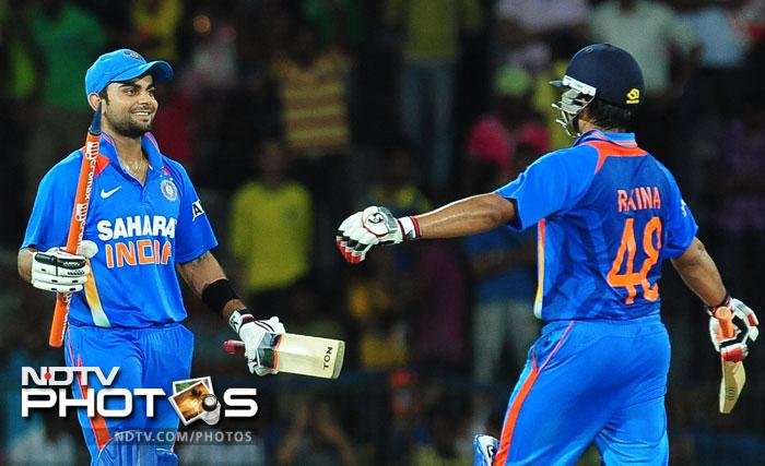 India beat Sri Lanka by six wickets in the 4th ODI and also won the series in the process. Riding high on Virat Kohli's brilliant century and Manoj Tiwary's four-for, Team India walked away with a comfortable win in 42.2 overs. (All AFP Photos)