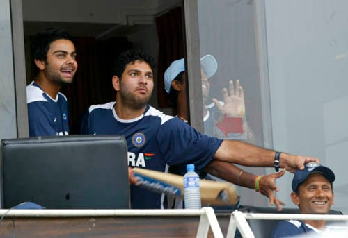 India's Virat Kohli, left and Yuvraj Singh, second left, share a light moment with bowling coach Venkatesh Prasad in Colombo.