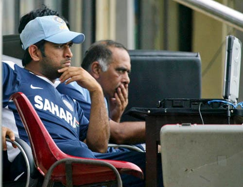 India captain MS Dhoni looks at a laptop in Colombo on Tuesday.