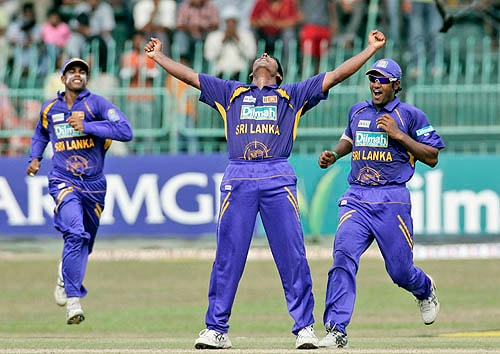 Chaminda Vaas of Sri Lanka celebrates after dismissing Yuvraj Singh, who became his 400th wicket in ODIs.