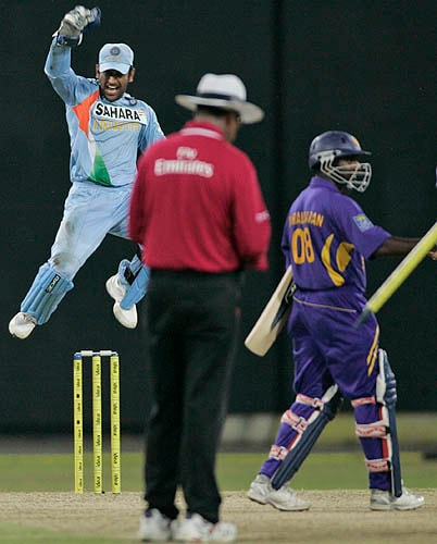 M.S. Dhoni jumps in the air to celebrate India's first series win in Sri Lanka.