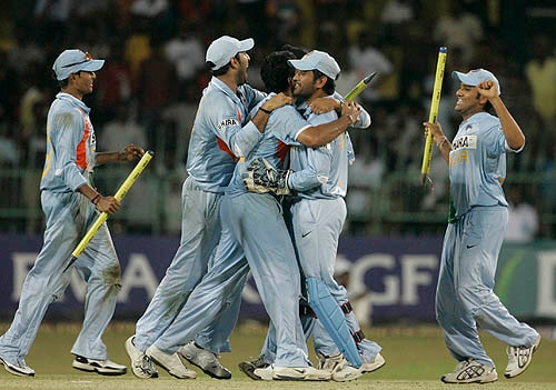 The Indian team celebrates with captain M.S. Dhoni (center) after winning the series against Sri Lanka.