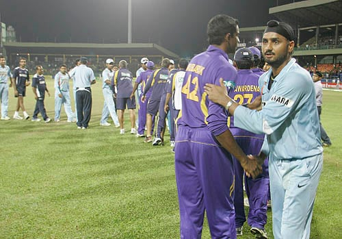 Harbhajan Singh shakes hands with a Sri Lankan player after the fourth ODI on Wednesday.