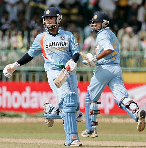 Virat Kohli and Gautam Gambhir take a run against Sri Lanka on Wednesday.