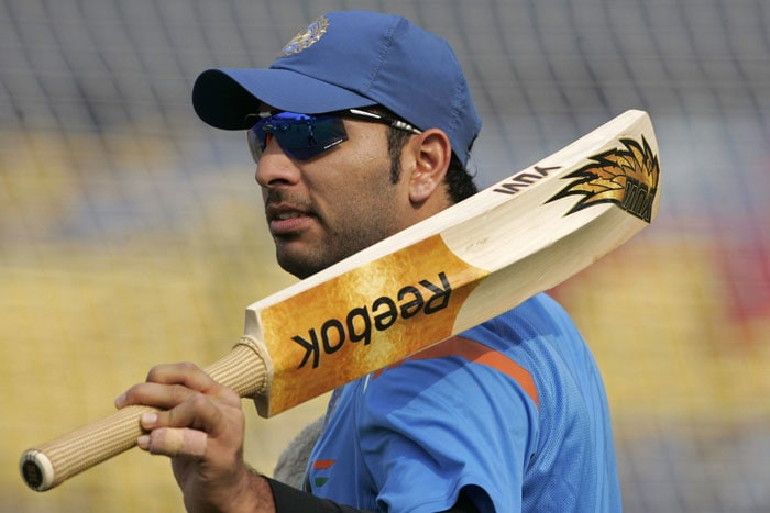 Yuvraj Singh acknowledges the crowd during a practice session prior to the third ODI between India and Sri Lanka in Cuttack. (AP Photo)