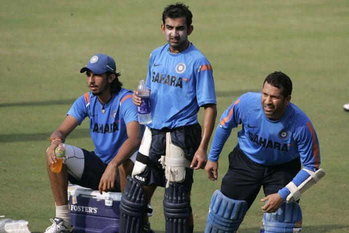 Sachin Tendulkar gestures as Gautam Gambhir and Ishant Sharma look on during a practice session prior to the third ODI between India and Sri Lanka in Cuttack. (AP Photo)