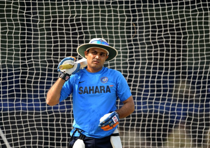 Virender Sehwag gestures during a practice session at the Barabati Stadium in Cuttack ahead of the third ODI against Sri Lanka. (AFP Photo)