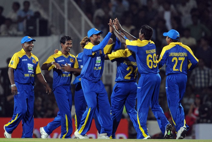 Sri Lankan cricketers celebrate after taking the wicket of Indian cricketer Yuvraj Singh during the first Twenty20 match between India and Sri Lanka in Nagpur. (AFP Photo)