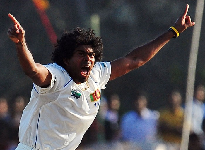 Sri Lankan cricketer Lasith Malinga celebrates the dismissal of Indian cricketer Sachin Tendulkar during the fourth day of the first Test match between Sri Lanka and India at The Galle International Cricket Stadium in Galle on July 21, 2010. (AFP Photo)
