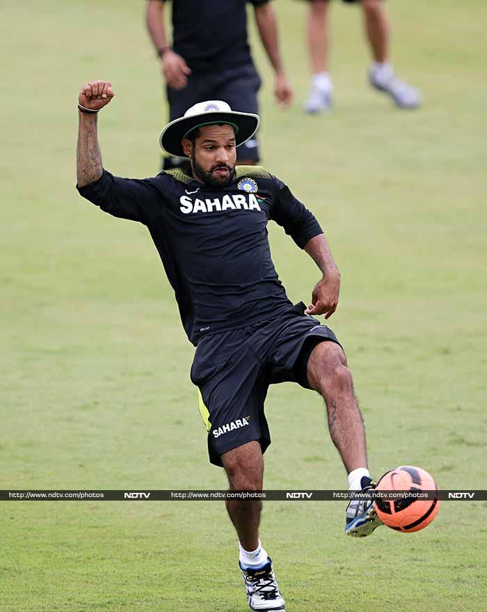 Stick your right hand up, stick your left leg out, and shake it all about... Shikhar Dhawan dances to the boogie-woogie! (AFP image)