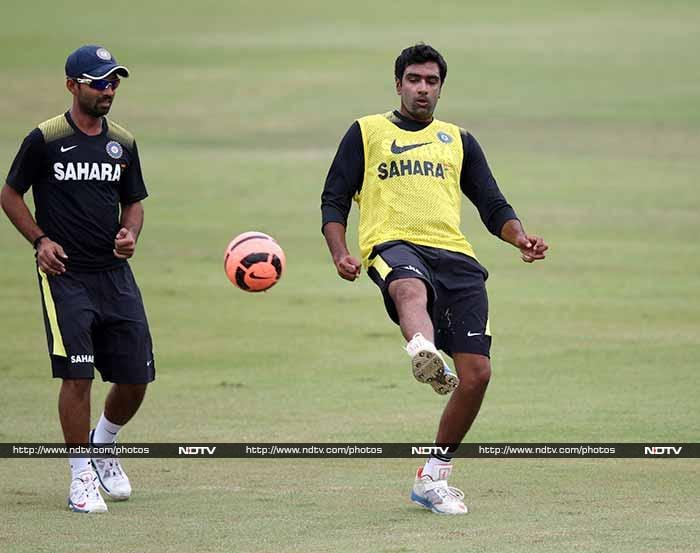 Ajinkya Rahane seems in awe of R Ashwin's footballing skills. Rahane is not too bad with the red ball in hand either, having run out both Graeme Smith and Faf du Plessis in the first Test. (AFP image)