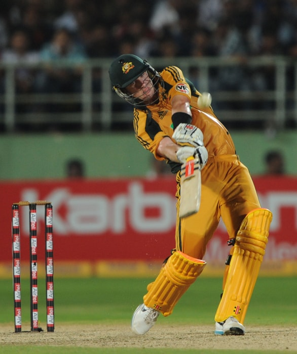 Australian cricketer Cameron White hits an overboundary during the second ODI between India and Australia at The Y.S. Rajasekhara Reddy ACA-VDCA Cricket Stadium in Visakhapatnam. (AFP Photo)