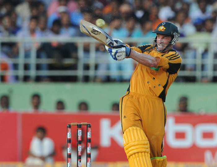 Australian cricketer Michael Hussey plays a shot during the second ODI between India and Australia at The Y.S. Rajasekhara Reddy ACA-VDCA Cricket Stadium in Visakhapatnam. (AFP Photo)