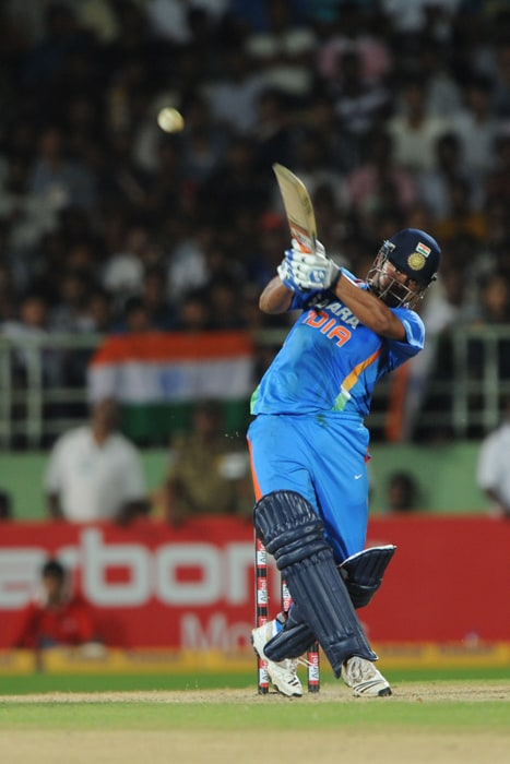 Indian cricketer Suresh Raina plays a shot during the second ODI between India and Australia at The Y.S. Rajasekhara Reddy ACA-VDCA Cricket Stadium in Visakhapatnam. (AFP Photo)