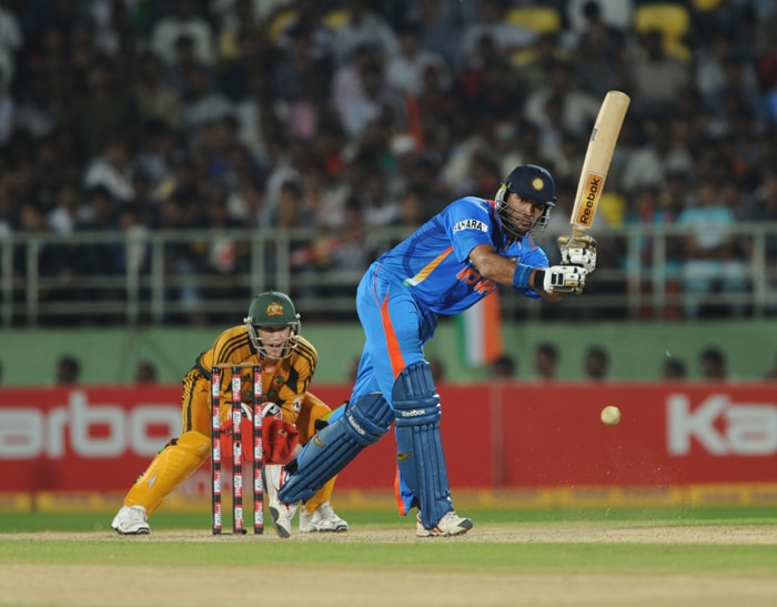 Indian cricketer Yuvraj Singh plays a shot watched by Australia's Tim Paine during the second ODI between India and Australia at The Y.S. Rajasekhara Reddy ACA-VDCA Cricket Stadium in Visakhapatnam. (AFP Photo)