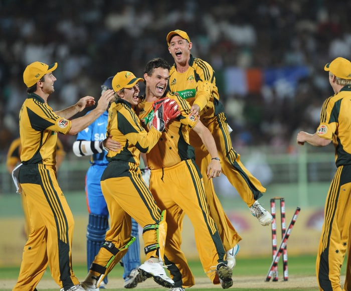 Australian cricketers greet Clint McKay (C) for the dismissal of unseen Indian batsman Shikhar Dhawan during the second ODI between India and Australia at The Y.S. Rajasekhara Reddy ACA-VDCA Cricket Stadium in Visakhapatnam. (AFP Photo)