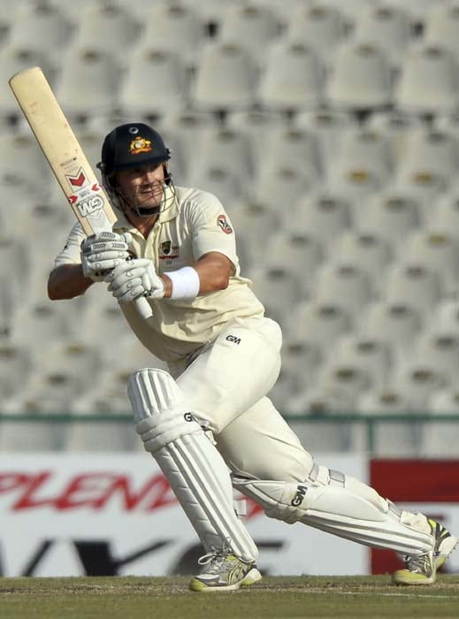 Shane Watson plays a shot during his unbeaten knock of 101 on Day 1 of the 1st Test in Mohali. (AFP Photo)