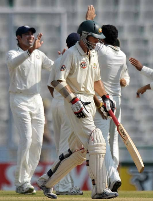 Australian opener Simon Katich walks back after being caught in front of the wicket by Zaheer Khan. (AFP Photo)