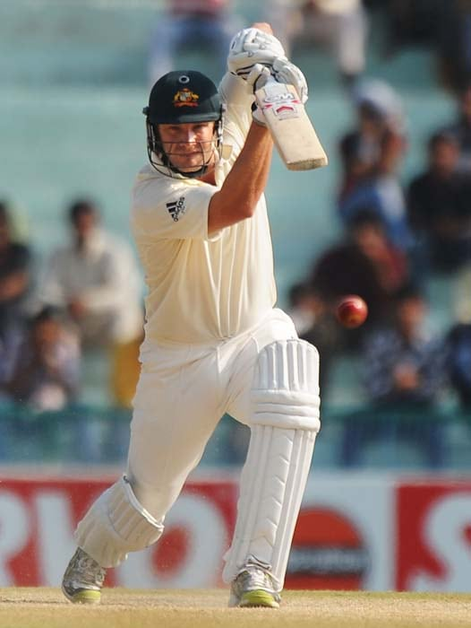 Australian cricketer Shane Watson plays a shot during the fourth day of the first Test between India and Australia in Mohali. (AFP Photo)