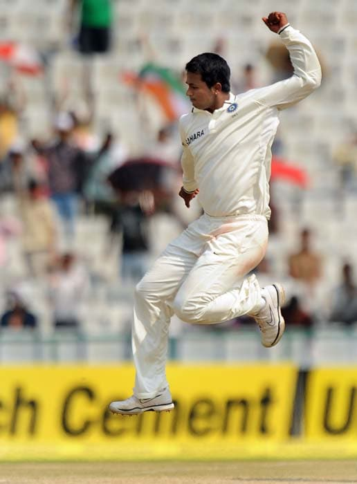 Indian cricketer Pragyan Ojha jumps in the air to celebrate the wicket of Australian batsman Simon Katich during the fourth day of the first Test between India and Australia in Mohali. (AFP Photo)