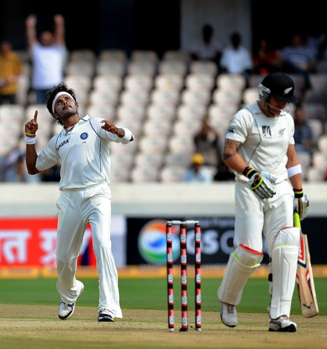 India cricketer Shanthakumaran Sreesanth (L) celebrates the wicket of New Zealand Brendon McCullum (R) during the first day of the second Test match between India and New Zealand at The Rajiv Gandhi International Cricket Stadium in Hyderabad. (AFP Photo)