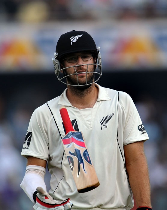 New Zealand's captain Daniel Vettori tosses his bat after his dismissal on the second day of the second Test match between India and New Zealand at The Rajiv Gandhi International Cricket Stadium in Hyderabad. (AFP Photo)
