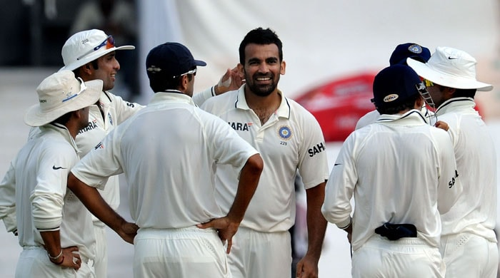 India's cricketer Zaheer Khan (C) celebrates the wicket of New Zealand's cricketer Kane Williamson with teammates on the second day of the second Test match between India and New Zealand at The Rajiv Gandhi International Cricket Stadium in Hyderabad. (AFP Photo)