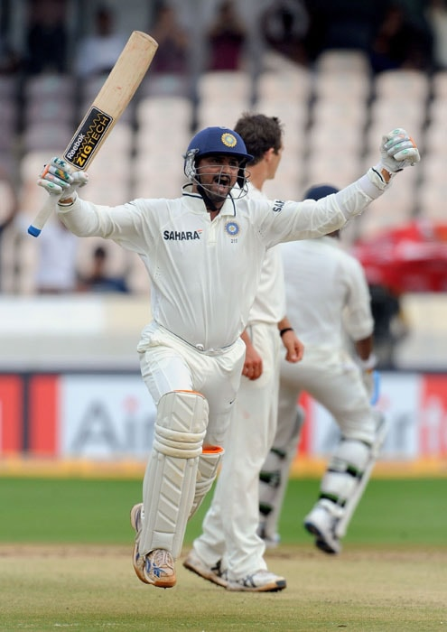 India's cricketer Harbhajan Singh jumps in air as he celebrates his century on the fourth day of the second Test match at Rajiv Gandhi International cricket stadium in Hyderabad. (AFP Photo)