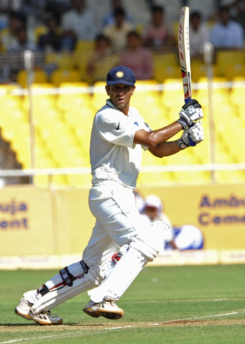 Indian cricketer Rahul Dravid plays a shot during the first day of the first Test match between India and New Zealand at The Sardar Patel Gujarat Cricket Stadium at Motera on the outskirts of Ahmedabad. (AFP PHOTO)