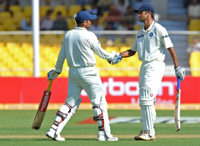 Indian cricketer Rahul Dravid (R) congratulates Virender Sehwag as he completes 150 runs during the first day of the first Test match between India and New Zealand at The Sardar Patel Gujarat Cricket Stadium at Motera on the outskirts of Ahmedabad. (AFP PHOTO)