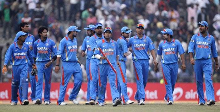 Indian team captain Gautam Gambhir leads the team out after winning the first match of the five match one-day cricket series against New Zealand in Guwahati. (AP Photo)