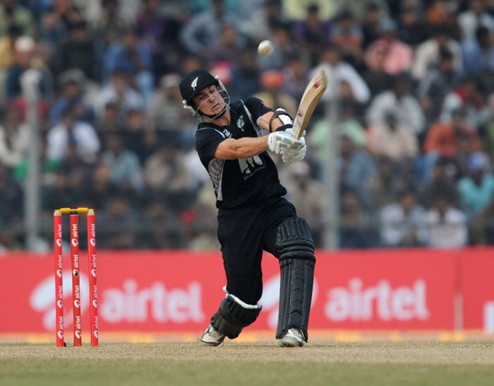 Nathan McCullum plays a shot during the first One-Day International against India at Nehru Stadium in Guwahati. (AFP Photo)