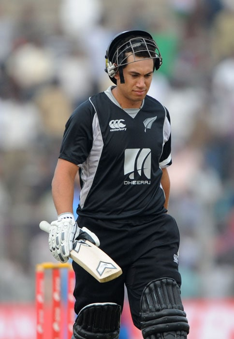 New Zealand's player Ross Taylor reacts as he leaves the ground after being dismissed during the first one-day International cricket match against New Zealand at Nehru Stadium in Guwahati. (AFP Photo)
