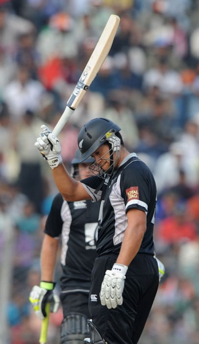 New Zealand's Ross Taylor raises his bat scoring fifty runs watched by teammate Scott Styris during the first one-day International cricket match against New Zealand at Nehru Stadium in Guwahati. (AFP Photo)