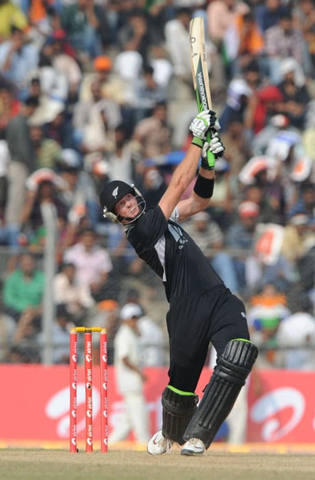 New Zealand's Martin Guptill plays a shot during the first one-day International cricket match against New Zealand at Nehru Stadium in Guwahati. (AFP Photo)