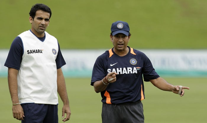 India's Sachin Tendulkar, right, with teammate Zaheer Khan, left, during their training at the SuperSport Park in Centurion. (AP Photo)