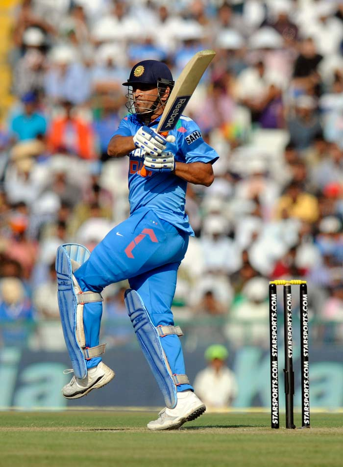 Mahendra Singh Dhoni kept his cool after Virat Kohli's departure and notched up his ninth hundred in ODI. He also became the first Indian to hit a century at PCA in Mohali.