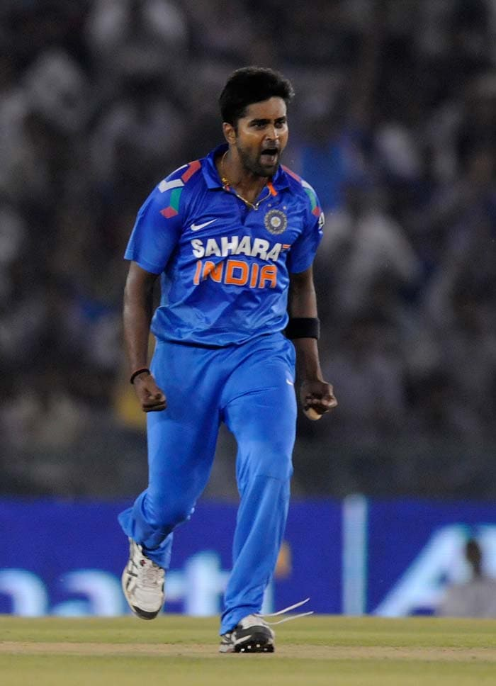 Vinay Kumar gave India their first wicket when he removed in-form Phillip Hughes in the 13th over. Vinay finished with 2/50.