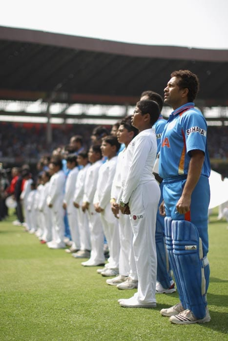 Sachin Tendulkar sings the national anthem during the 2011 ICC World Cup Group B match between India and England at M. Chinnaswamy Stadium in Bangalore. (Getty Images)