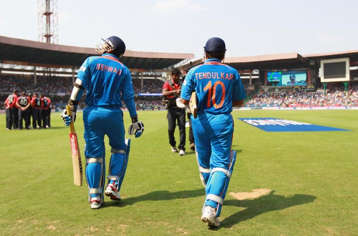 Virender Sehwag and Sachin Tendulkar enter the stadium during the 2011 ICC World Cup Group B match between India and England at M. Chinnaswamy Stadium in Bangalore. (Getty Images)