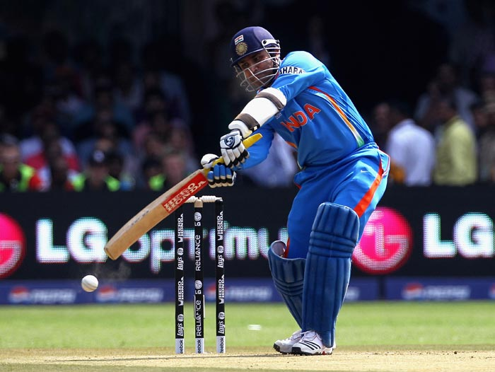 Virender Sehwag cover drives for four during the 2011 ICC World Cup Group B match between India and England at M. Chinnaswamy Stadium in Bangalore. (Getty Images)