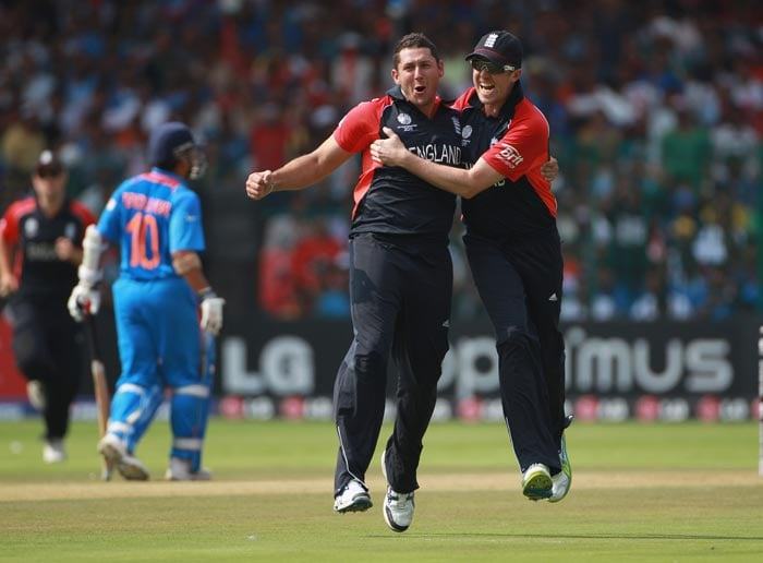 Tim Bresnan celebrates with Graeme Swann after taking the wicket of Virender Sehwag during the 2011 ICC World Cup Group B match between India and England at M. Chinnaswamy Stadium in Bangalore. (Getty Images)