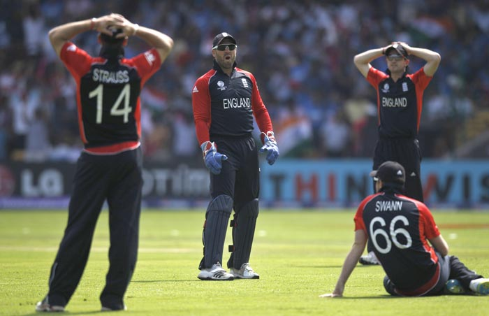 English players react as the first ball to Virender Sehwag faced took an edge and landed in no mans land as England faced India in Bangalore. (AP Photo)