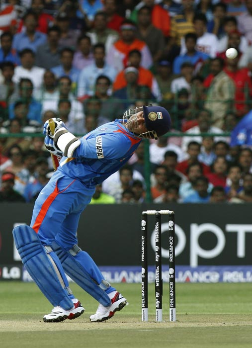 Virender Sehwag ducks away from a rising delivery during the Group B Cricket World Cup match between India and England in Bangalore. (AP Photo)