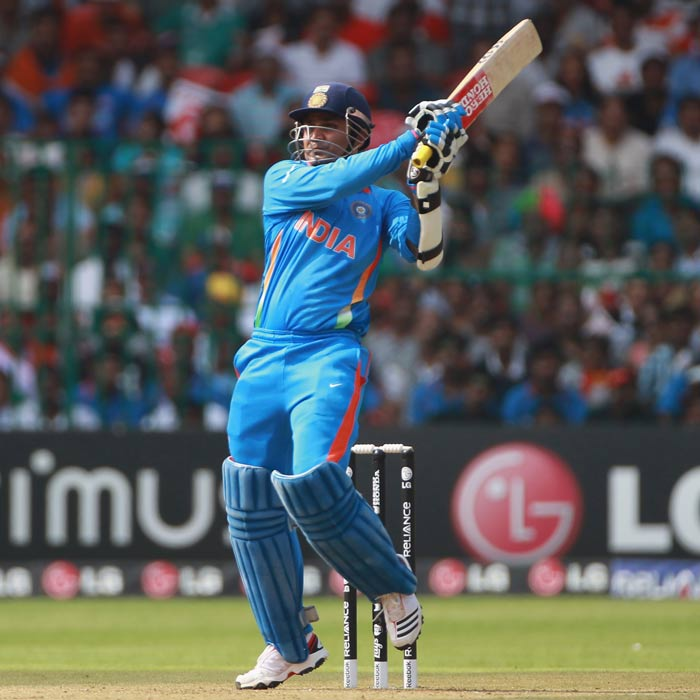 Sachin Tendulkar and Virender Sehwag started the innings in a rather mixed fashion. Although the runs were coming at ease, Virender Sehwag survived two edges which could have gone anywhere. (AFP Photo)